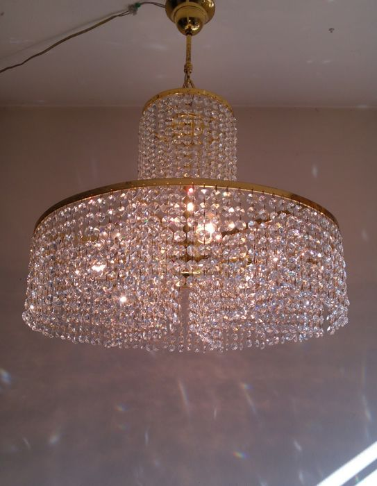 A brass and good quality crystal chandelier, 1970's