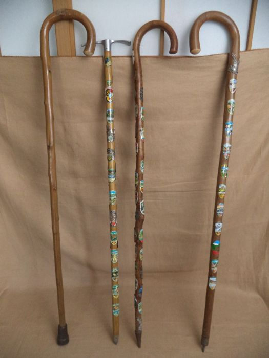 4 Old wooden walking sticks - 63 plaques