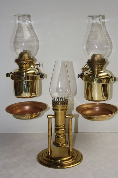 Two brass wall lamps on petroleum with gimbal suspension marked DHR Holland and copper tilt candle holder