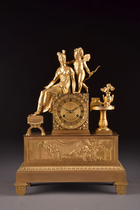 Imposing bronze fire-gilt Empire 1st period mantel clock - with a beautiful image of a young lady and a cherub - France, ca. 1800
