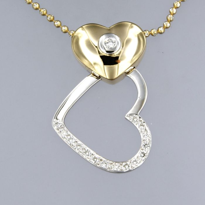 14 kt bicolour gold necklace with an 18 kt bicolour gold pendant set with a brilliant cut diamond approx. 0.50 carat in total