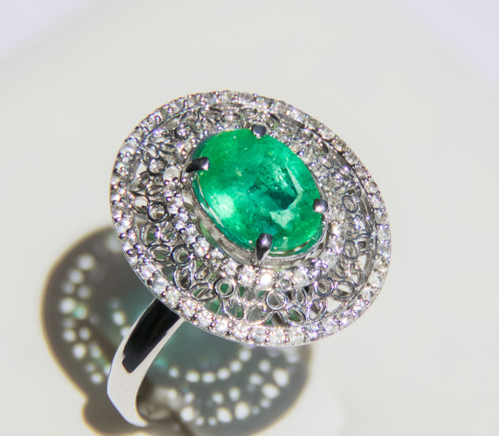 2.06 ct. Emerald And Sapphires White Gold Ring.