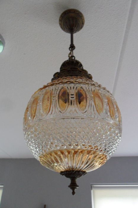 A glass hanging lamp with polished fan, diamond, bow and oval patterns - transparent glass and copper mounting, mid 20th century