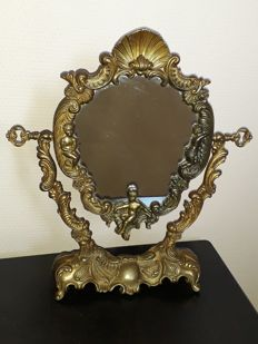 Mirror on old foot in bronze 1900-1950