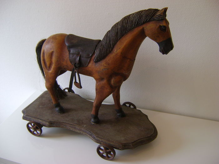 Beautiful wooden rocking horse on iron wheels - France - 2nd half 20th century