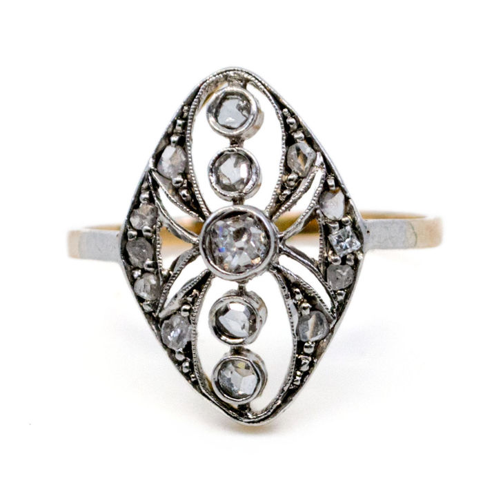 Ring 0,10ct (J SI1) Cushion Cut Diamond and 0,20ct small Rose Cut Diamonds in 18k Gold and White Gold.