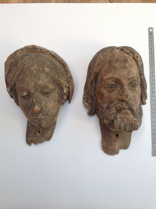 Head of Christ or Saint and a head of Mary in carved polychromed wood - 18th century, may be earlier
