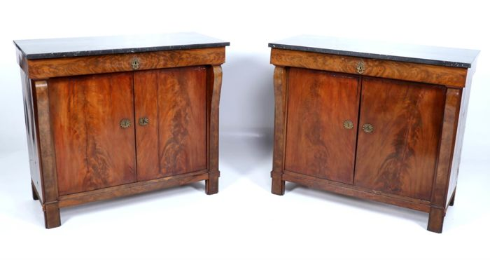 A set of Empire mahogany dresser, with anthracite veined marble top and original brass shield mounting, France, circa 1800