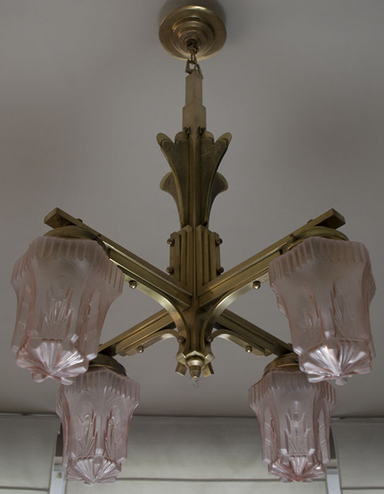Four-branched brass chandelier - partly matte pink glass globes.
