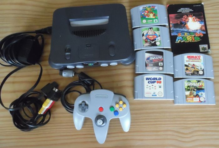 Nintendo 64 including 6 games like Super Mario + Superman and more