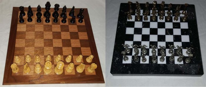 2 chess boards wood and marble with chess pieces