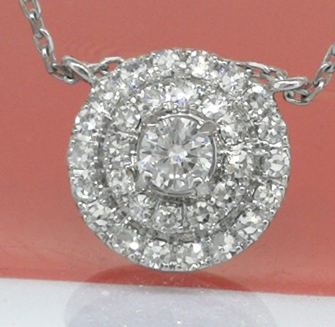 14 kt gold pendant with 31 diamonds brilliant, 0.65 ct in total on a 14 kt gold necklace of 42 cm in length - No reserve price