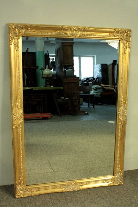 Beautiful, large mirror in a wooden, golden frame.  102 x 72 cm. Poland