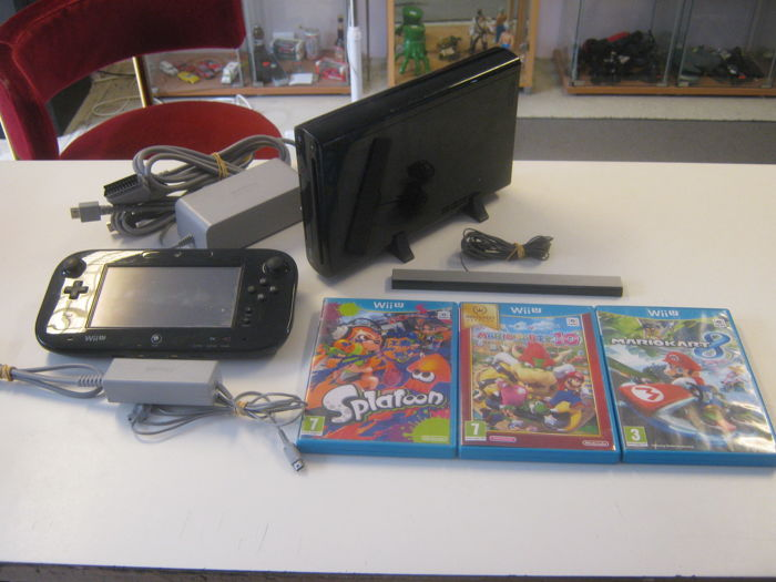 Originel Nintendo WII U (32gb version) + 3 games like: Mario party 10 + Mario Kart + Splatoon.