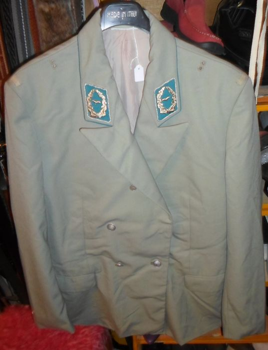 Uniform jacket with emblems