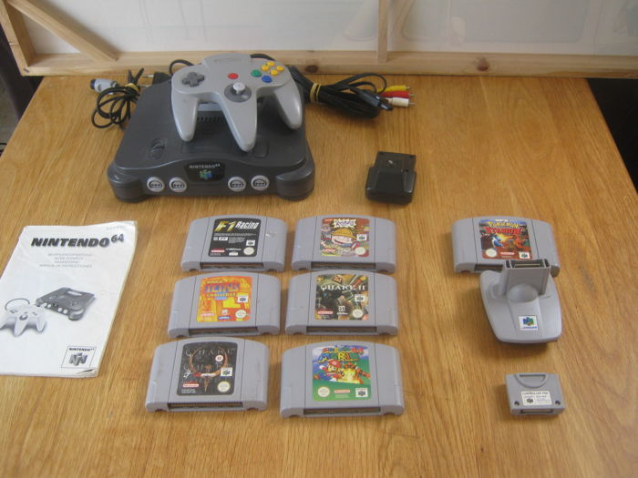 Nintendo 64 with transfer pack + Memorycard , rumble pack and 7 games . Like Pokemon Stadium +Mario + Rugrats + Quake 2 and more
