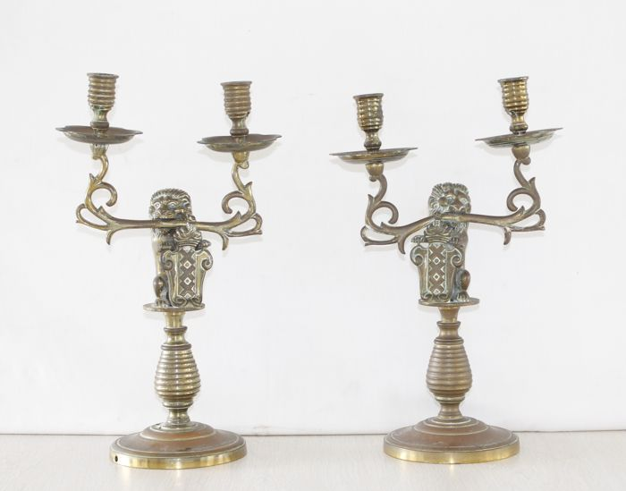 Two magnificent brass two-light candlesticks - with lion and the Amsterdam coat of arms