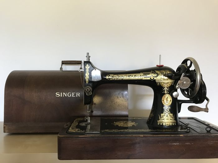 A Singer 127K sewing machine with dust cover, 1927