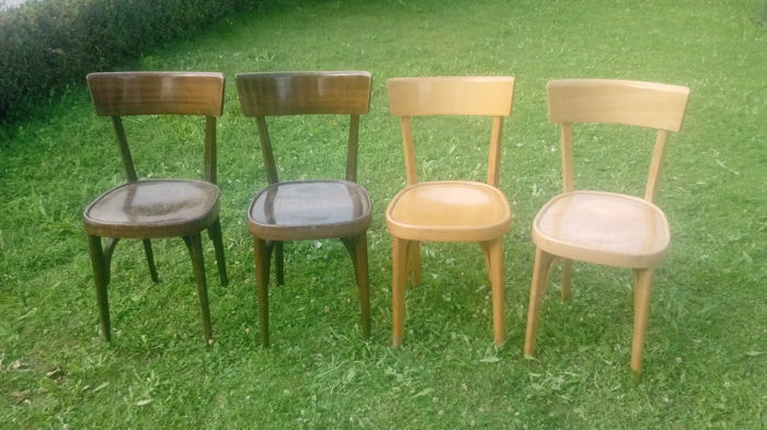 Two Beech wood and two Walnut chairs, 1940s-50s
