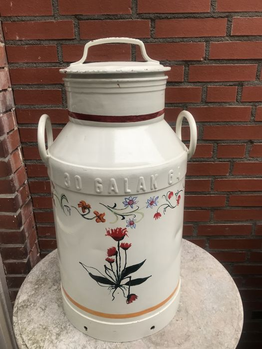White painted cast iron milk churn