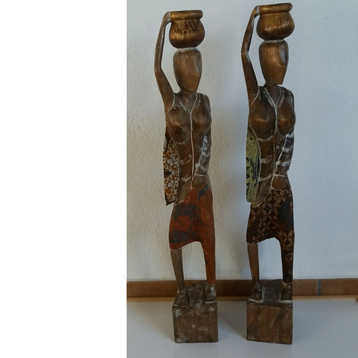 2 large handmade wooden African sculptures of water-carrying women, Africa, 20th century