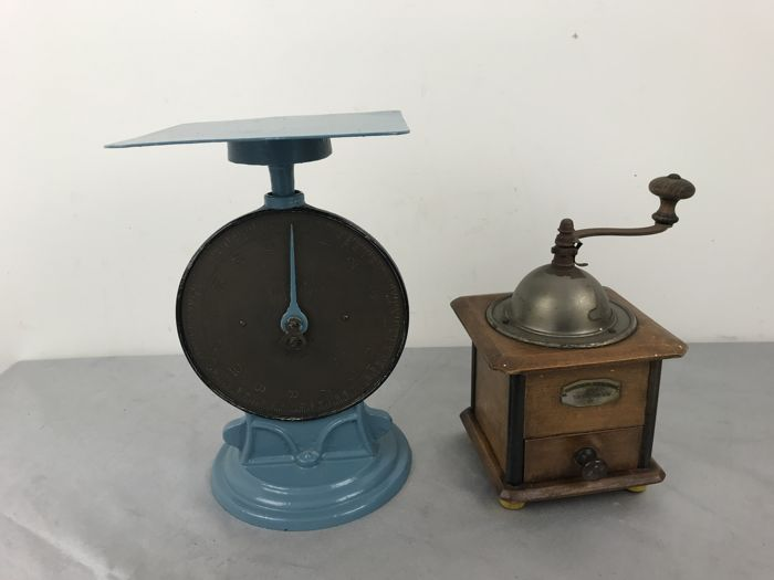 A blue painted kitchen scale + wooden coffee grinder