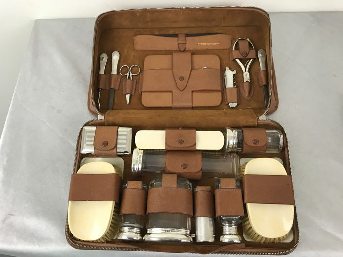 An 18-piece mostly Sterling silver shaving set in leather case