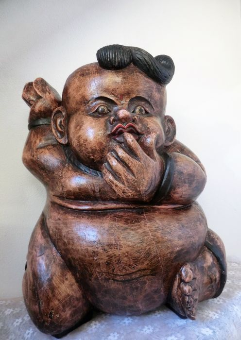 Large wooden image of a Scandinavian baby troll