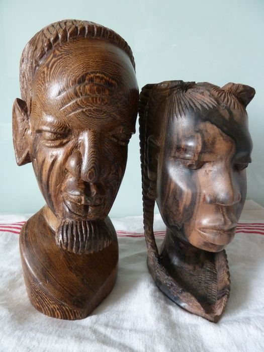 Beautiful pair of man and woman busts made of heavy hand carved wood