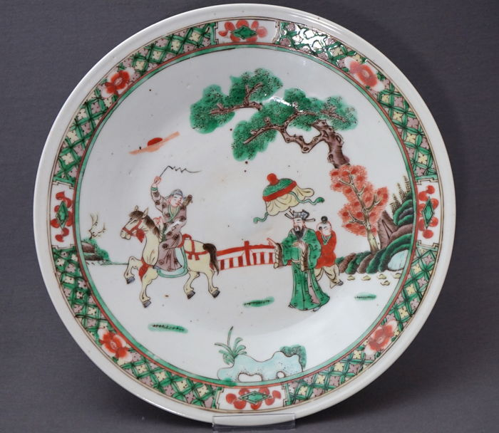 Large dish decorated with rider on horse and dignitary in landscape with trees - China - late 19th century