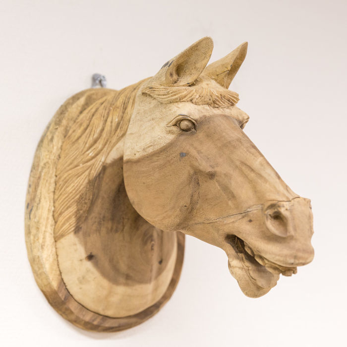 Carved wooden horse head wall sculpture