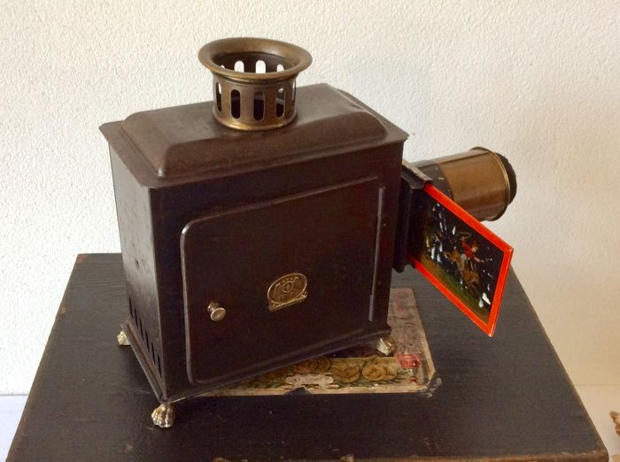 Magic lantern from the German city of Nuremberg, Ernst Plank (E P) complete with burner and magic lantern images and extra electric fitting and lamp, box dimensions are L-W-H 34-23-13, circa 1900