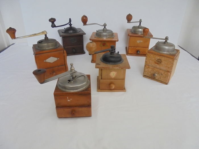 Collection with seven old hand used coffee grinders