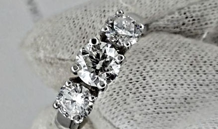 1.80 ct round three-stone diamond ring in white gold