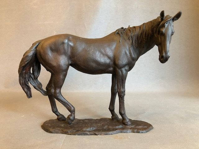 Cast iron sculpture of a horse