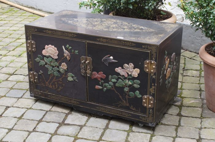 Richly decorated side/television table, inlaid with nephrite jade and stones.