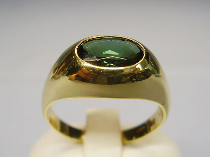 14 karat yellow gold ring with oval faceted natural and verified forest green tourmaline of 2 ct.