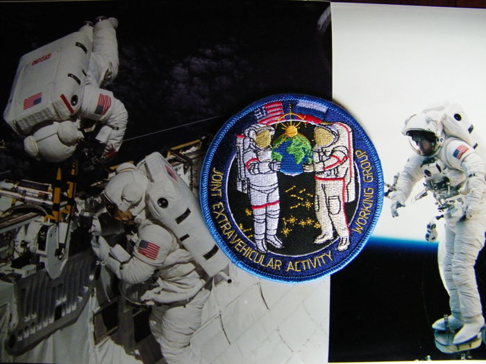 Americans and Russians walking in space: Two NASA photos and one embroidered Russian patch
