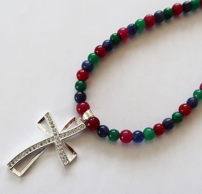 Necklace made of ruby, emerald and sapphire gems, adorned with a carved silver cross