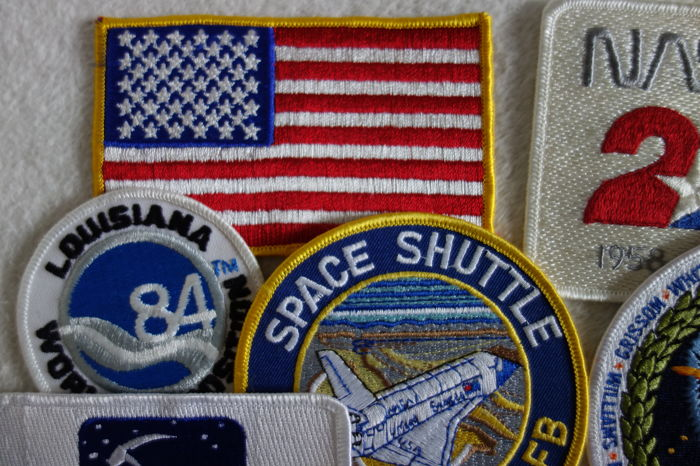 11 space patches of Shuttle to Soyuz