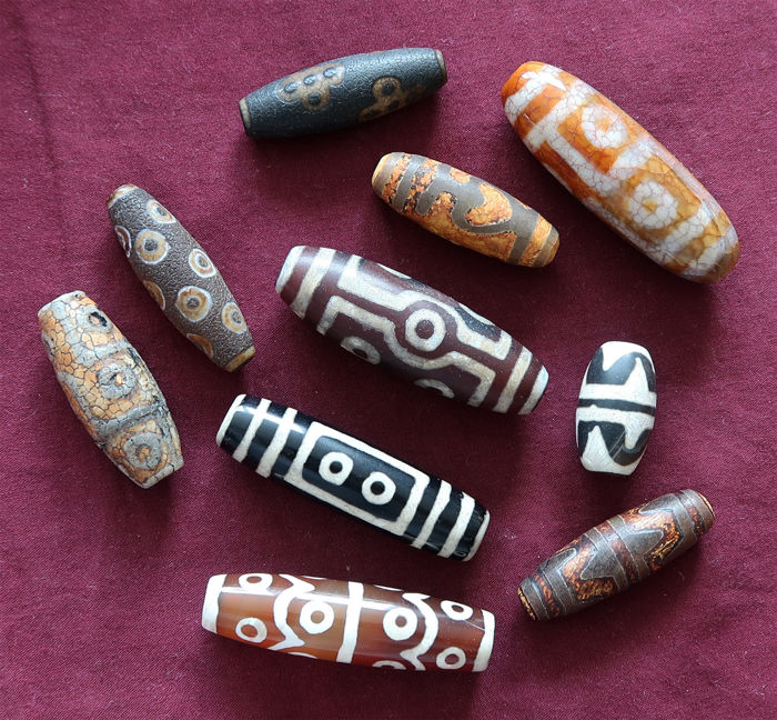 Ten lucky charms in 'dzi' agate beads decorated with various patterns