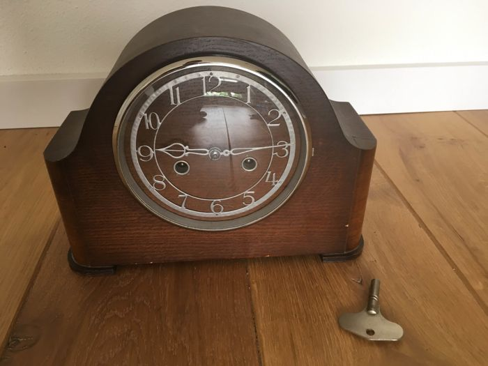 A Smiths pendulum clock in a wooden case