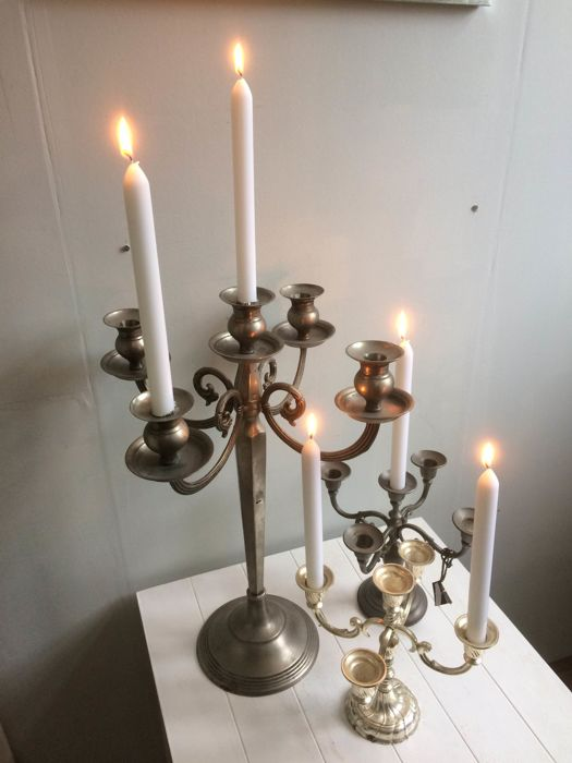 Three five-arm candlesticks made of different materials