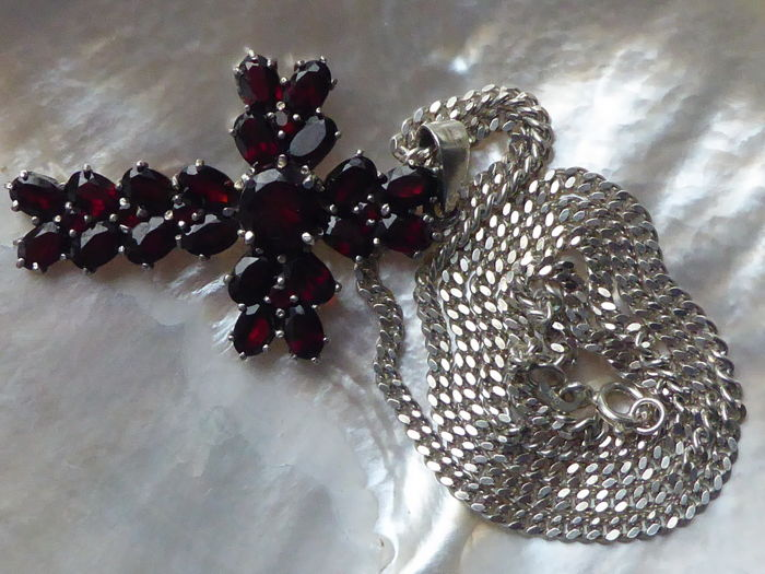 Silver cross pendant set with garnets on silver necklace