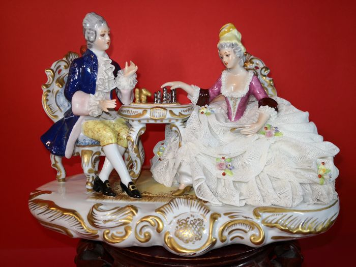 Beautiful polychrome sculpture made of high end precious German porcelain, depicting Lady and Knight playing chess
