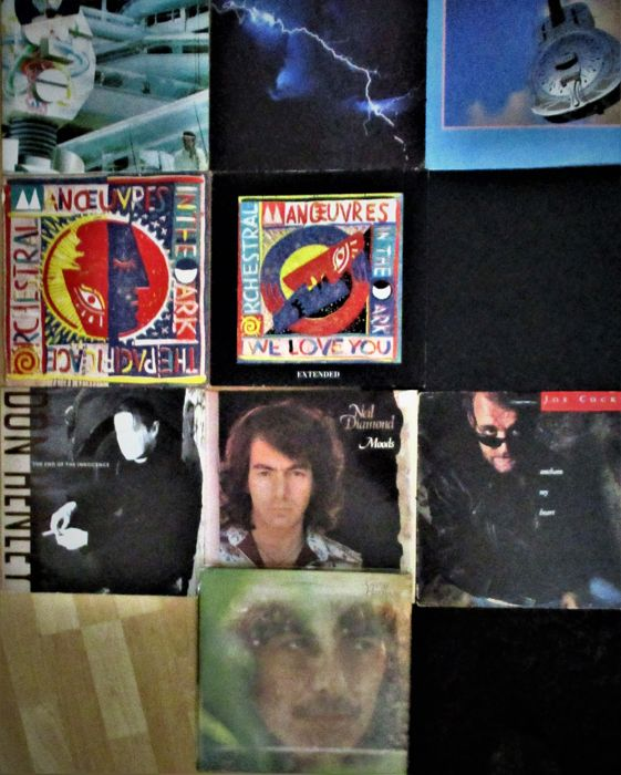 This lot contains 10 records with great music, for instance Dire Straits, Ultravox, George Harrison and many more.