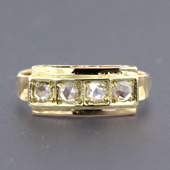 14 kt bi-colour gold ring set with 4 rose cut diamonds of approx. 0.24 ct in total.