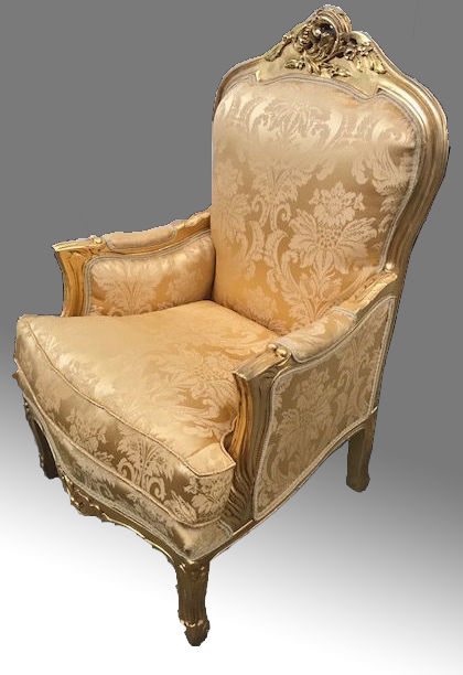 Golden armchair in French classic style, with fine gold satin and gold leaf wood