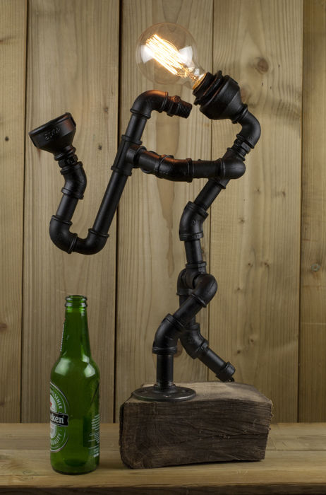 Steam-punk industrial lamp in the form of a retro saxophonist