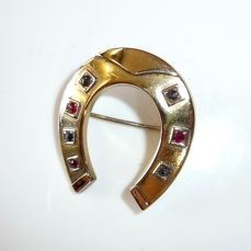 Art Deco brooch horseshoe 14 kt / 585 gold with approx. 0.30 ct. Rubies / sapphires lucky charm: horseshoe